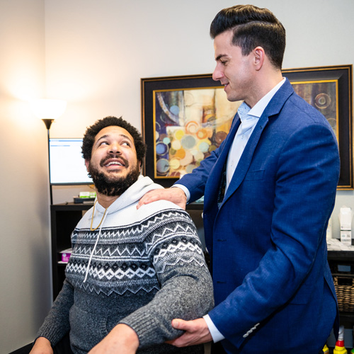 Chiropractor Tigard OR Tony Rhodes with Patient